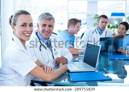 Team of doctors working on their files in the meeting room - stock photo