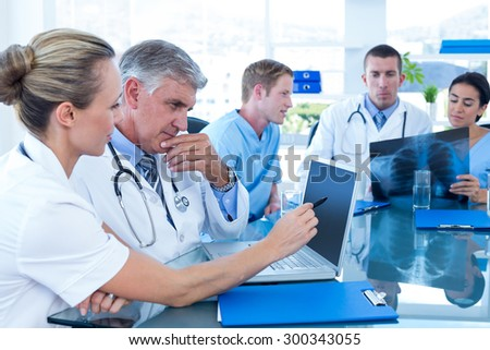 Team of doctors working on their files in the meeting room