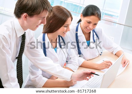 Team of doctors working together - stock photo