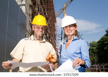 team of engineers at the construction - stock photo