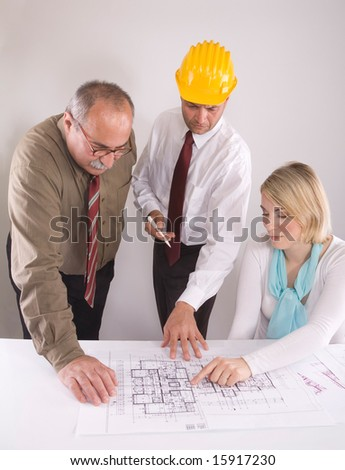 team of engineers at the meeting - stock photo