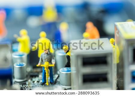 Team of engineers repairing circuit mother board. Computer repair concept - stock photo