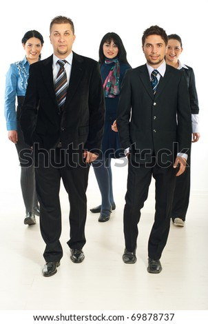 Team of five business people with men in front of image walking - stock photo