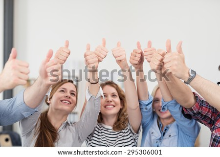 Team of Five Young Business People Inside the Office, Showing Thumbs Up Signs with Happy Facial Expressions. - stock photo