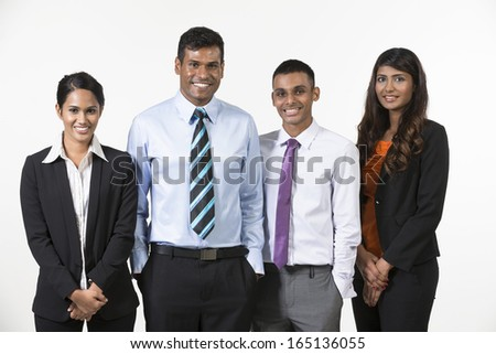 Team of four  happy Indian business people. isolated on a white background. - stock photo