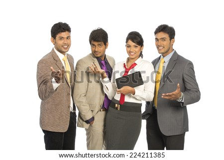 Team of four happy Indian business people on a white background.  - stock photo