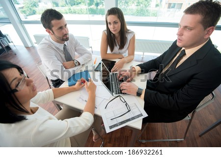 Team of four people working together in modern office