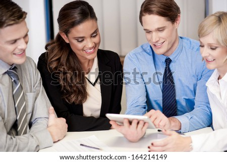 Team of friendly business people at work - stock photo