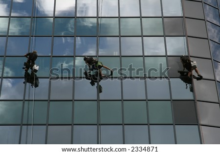 team of glass cleaning workers