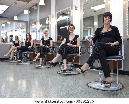 Team of hairdressers in a beauty salon - stock photo
