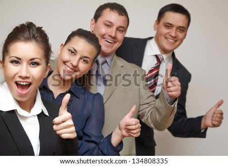 Team of happy business people showing success