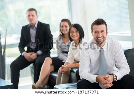 Team of happy successful business people posing - stock photo