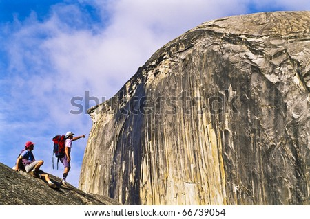 Team of hikers approaching Half Dome. - stock photo