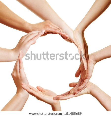 Team of many hands forming a circle - stock photo