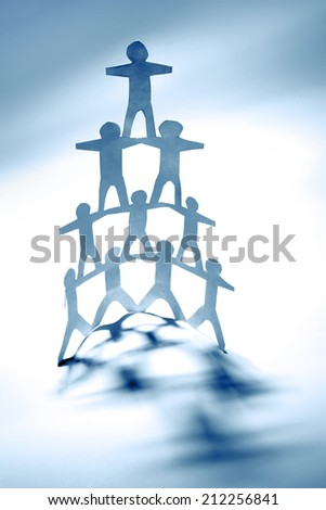 Team of paper doll people, human pyramid