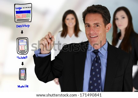 Team of people designing a website for mobile - stock photo