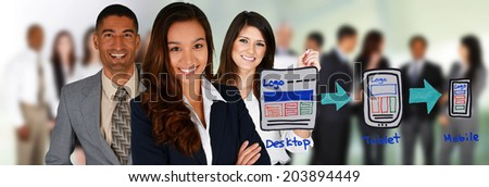 Team of people making a website together - stock photo