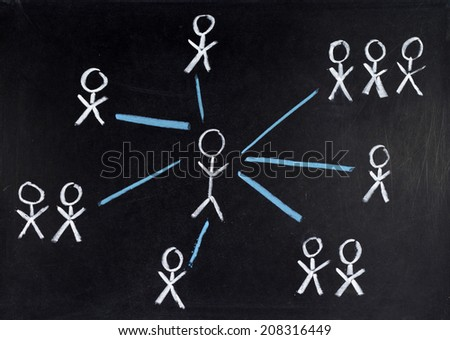 Team of people on a blackboard - stock photo