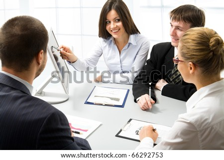 Team of people working in a office - stock photo
