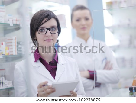 team of  pharmacist chemist woman group  standing in pharmacy drugstore - stock photo