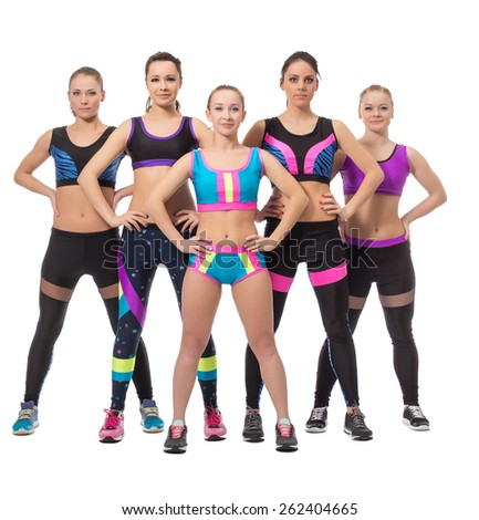 Team of pretty female athletes posing at camera - stock photo