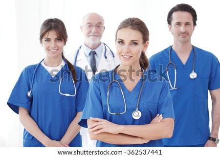 Team of professional doctors isolated on white background - stock photo