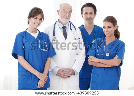 Team of professional doctors isolated on white background