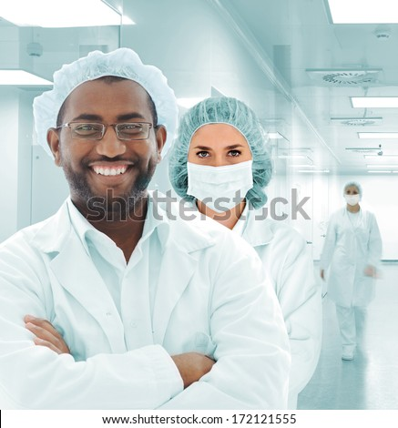 Team of scientists at modern hospital lab - stock photo