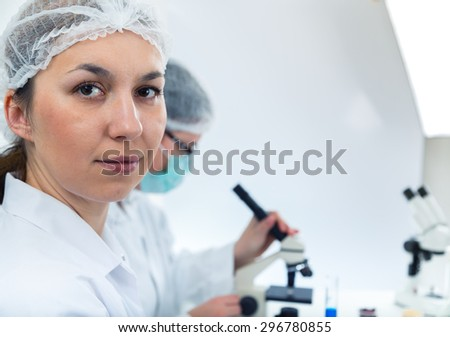 Team of scientists in a laboratory working on chemical testing - stock photo