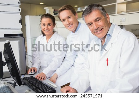 Team of scientists working together at the laboratory - stock photo