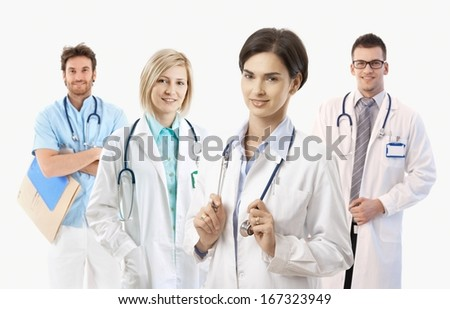 Team of smiling medical doctors on white background, portrait.