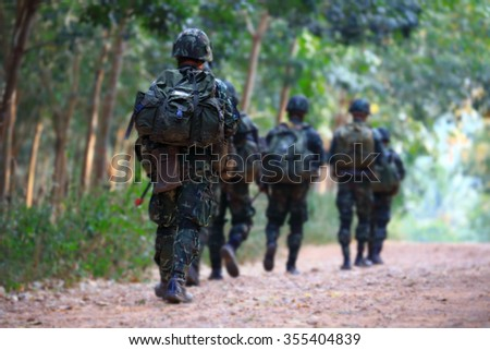 Team of soldiers walking - stock photo