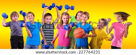 Team of sportive children friends with dumbbells and ball over yellow . Childhood, happiness, active sports lifestyle concept - stock photo