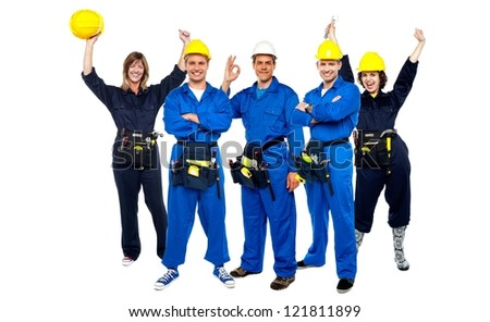 Team of successful architects posing together. Celebrating cheerful moment together. - stock photo