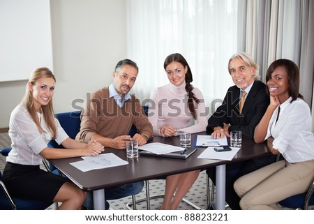 Team of successful business people at a meeting in office - stock photo