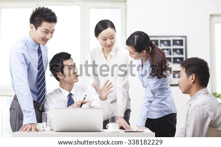 Team of successful colleagues working together - stock photo