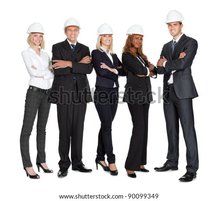 Team of successful construction workers isolated on white background - stock photo