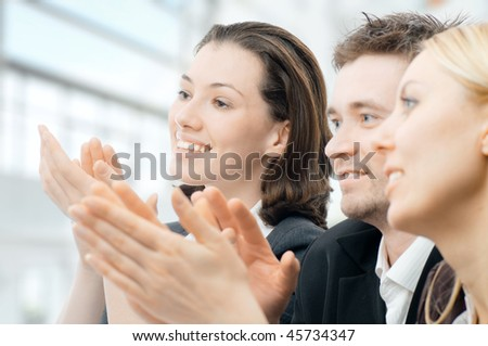 team of successful smiling young business people - stock photo