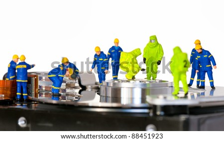 Team of technicians repair hard disk. Hard Drive repair concept - stock photo