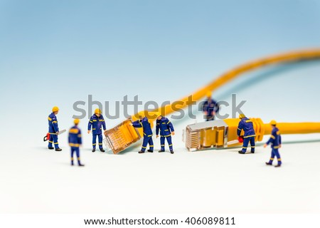 Team of techs with RJ45 network cable. Macro photo - stock photo