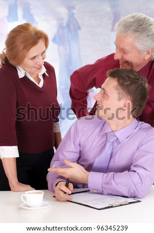 team of three folk sitting on a light - stock photo