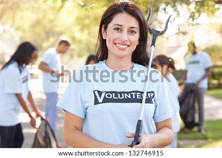 Team Of Volunteers Picking Up Litter In Suburban Street - stock photo