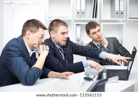 Team of young business men working together at office - stock photo