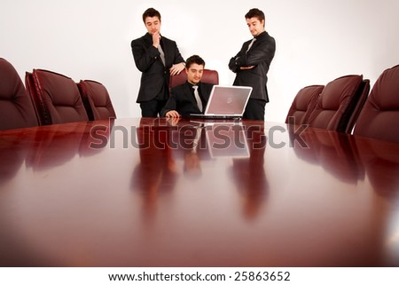 Team of young business people, analyze results. - stock photo