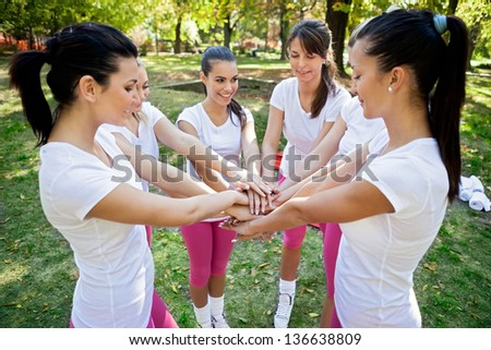 Team of young sporty women - stock photo
