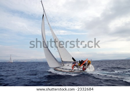 Team on a sailing cruise - stock photo