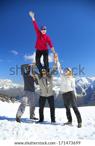 Team on the snowy mountain top. Sport and active life concept - stock photo