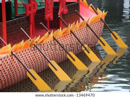 Team: Oriental Dragon Boat's paddle - stock photo