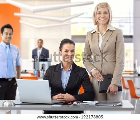 Team portrait of smiling of businesspeople at office. - stock photo