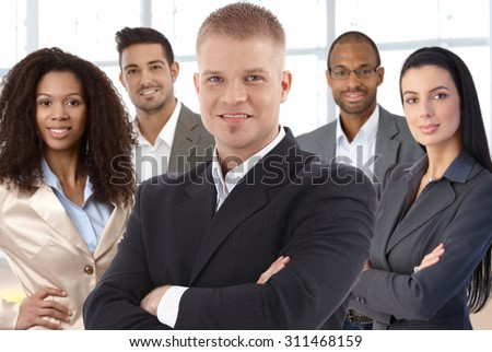 Team portrait of successful young businesspeople at office smiling happy. - stock photo